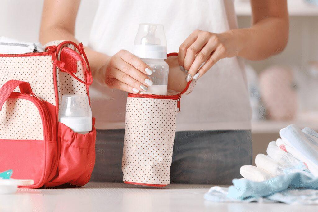 mom packing a breastmilk cooler bag