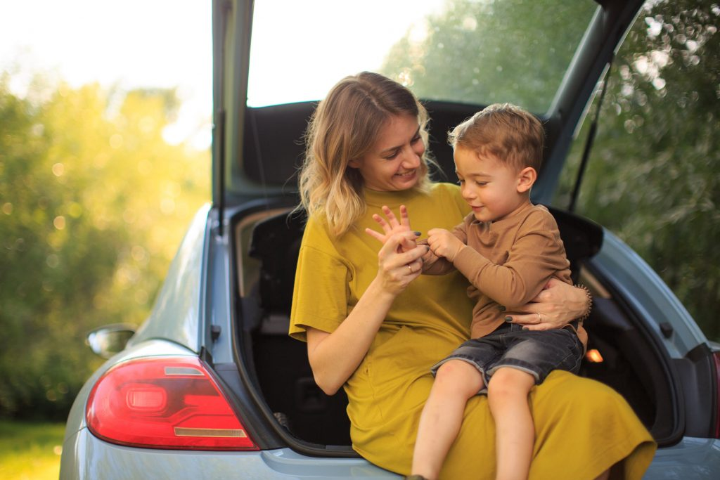 mom and son sitting in a car